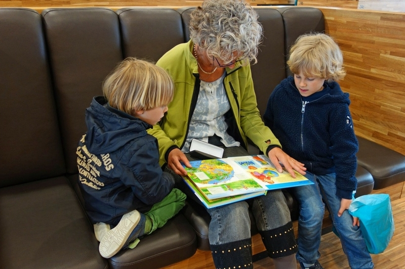 Grandmother reading to her grandchildren