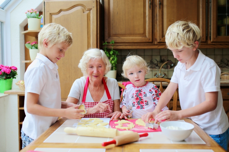 Family working in kitchen together